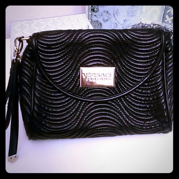 Versace Bags   Wristlet   Poshmark b9a361f597